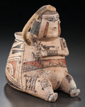 American Indian Art:Pottery, A CASAS GRANDES POLYCHROME FEMALE EFFIGY JAR. c. 1200 - 1450...