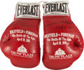 """Boxing Collectibles:Autographs, 1991 George Foreman and Evander Holyfield """"The Battle of the Ages"""" Signed Promotional Gloves Lot of 2...."""