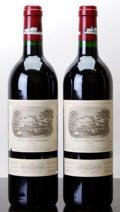 Red Bordeaux, Chateau Lafite Rothschild 1995 . Pauillac. 1lbsl, 1ltl.Bottle (2). ... (Total: 2 Btls. )