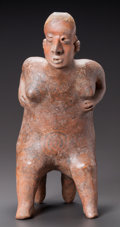 Pre-Columbian:Ceramics, A NAYARIT SEATED FIGURE WITH RESIST PAINTING. 200 BC - 200 AD...