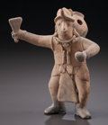 Pre-Columbian:Ceramics, A COLIMA SOLID FIGURE CARRYING OBJECTS...