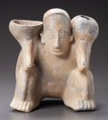 Pre-Columbian:Ceramics, A JALISCO CROUCHING HUNCHBACK SHOWN CARRYING VESSELS. c. 200 BC -200 AD...