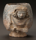 Pre-Columbian:Ceramics, A TEOTIHUACAN BLACKWARE VESSEL WITH MODELED FIGURE. c. 500 - 700AD...