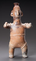 Pre-Columbian:Ceramics, A COLIMA STANDING FIGURE SHOWN HOLDING RATTLES. c. 200 BC - 200AD...