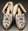 American Indian Art:Beadwork and Quillwork, A PAIR OF SANTEE SIOUX BEADED HIDE MOCCASINS. c. 1890...
