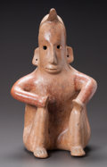 Pre-Columbian:Ceramics, A COLIMA FIGURE OF A SEATED SHAMAN. c. 200 BC - 200 AD...