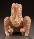 Pre-Columbian:Ceramics, A JALISCO CROUCHING HUNCHBACK. c. 200 BC - 200 AD...