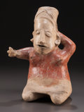 Pre-Columbian:Ceramics, A JALISCO SEATED FEMALE FIGURE. c. 200 BC - 200 AD...