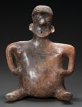 Pre-Columbian:Ceramics, A NAYARIT SEATED FIGURE IN THE FORM OF A PREGNANT WOMAN. c. 200 BC- 200 AD...
