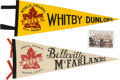 Hockey Collectibles:Others, 1958-59 Belleville McFarlands and Whitby Dunlops Amateur World Championship Pennants Lot of 2. ...