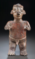 Pre-Columbian:Ceramics, A NAYARIT STANDING FIGURE HOLDING A FAN AND AN ANIMAL. c. 200 BC -200 AD...