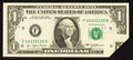 Error Notes:Foldovers, Fr. 1909-F $1 1977 Federal Reserve Note. About Uncirculated.. ...
