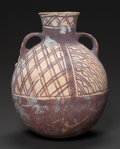 Pre-Columbian:Ceramics, A CHANCAY PAINTED URN WITH TWO HANDLES. c. 1300 - 1500 AD...