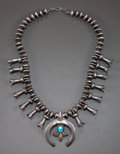 American Indian Art:Jewelry and Silverwork, A NAVAJO SQUASH BLOSSOM NECKLACE. c. 1950...