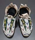 American Indian Art:Beadwork and Quillwork, A PAIR OF CHEYENNE CHILD'S BEADED HIDE MOCCASINS. c. 1890...