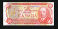 Canadian Currency: , BC-51a$50 1975 Gem Crisp Uncirculated. The paper is quite fresh with the embossing very pronounced on this colorful $50....