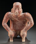 Pre-Columbian:Ceramics, A JALISCO SEATED HUNCHBACK FIGURE. c. 200 BC - 200 AD...