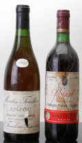 France Misc., Anjou . 1955 Moulin Touchais bsl, tl, 1ssos Bottle (1). Bodegas Franco-Espanolas Rioja . 1973 Royal Reser... (Total: 2 Btls. )