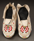American Indian Art:Beadwork and Quillwork, A PAIR OF CHEYENNE BEADED HIDE MOCCASINS...