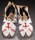 American Indian Art:Beadwork and Quillwork, A PAIR OF CHEYENNE BEADED HIDE MOCCASINS. c. 1890...