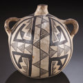 American Indian Art:Pottery, AN ACOMA BLACK-ON-WHITE CANTEEN. c. 1900...