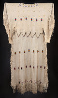 American Indian Art:Beadwork and Quillwork, A KIOWA BEADED AND FRINGED HIDE DRESS. c. 1945...