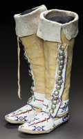 American Indian Art:Beadwork and Quillwork, A PAIR OF CHEYENNE BEADED HIDE HIGHTOP MOCCASINS. c. 1890...
