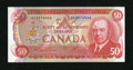 Canadian Currency: , BC-51a $50 Bank of Canada This series 1975 note is very stronglyembossed and were it a bit wider at right certainly would b...