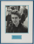 Music Memorabilia:Autographs and Signed Items, George Harrison Framed Autograph. A blue autograph album pagesigned in the early '90s by the late Beatles guitarist in blue...(Total: 1 Item)